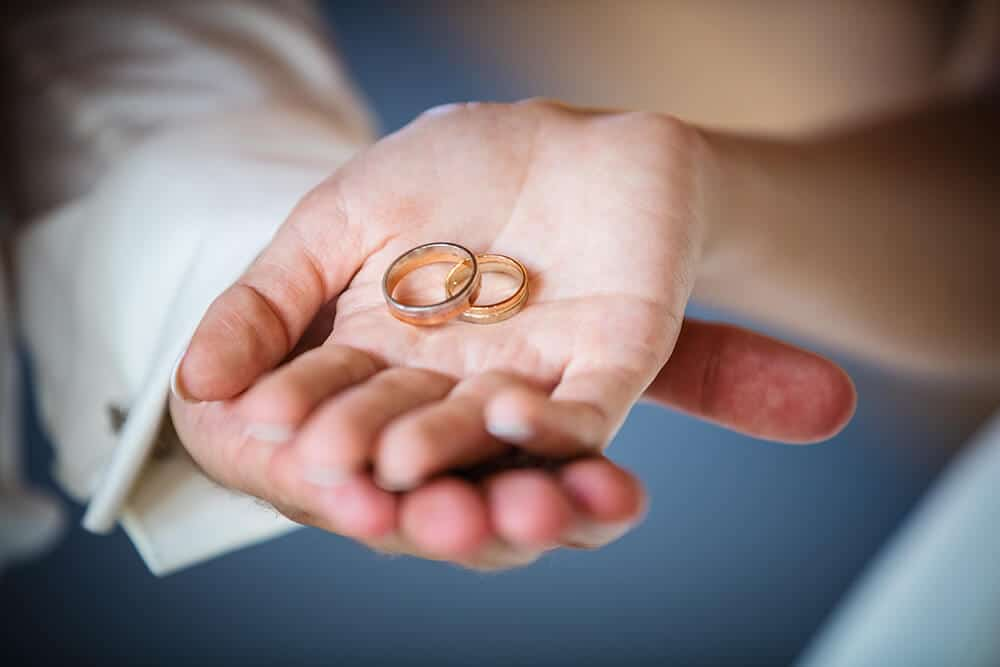 newlyweds rings in hand