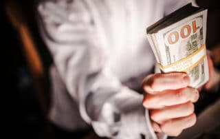 Cash Money Giveaway. Caucasian Businessman with Pile of Cash. Ten Thousand American Dollars.