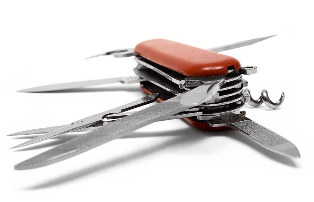 Red Multitool knife isolated on a white background.